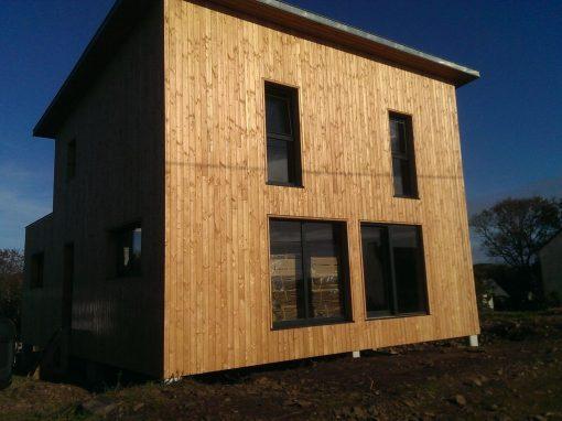 Maison ossature bois à Hopital Camfrout